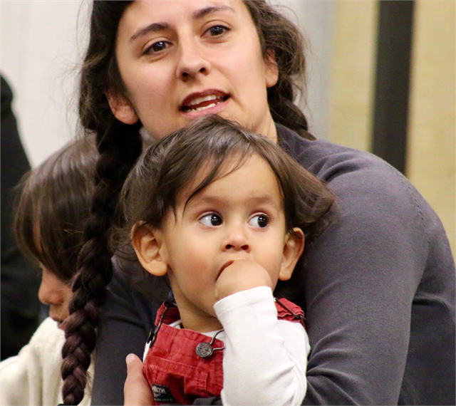 "Alida Cardos Whaley sits with her children as she listens to other guests at the Wisconsin Historical Society's ""Share Your Voice"" new museum multicultural listening session May 15, 2019 at the United Community Center in Milwaukee."