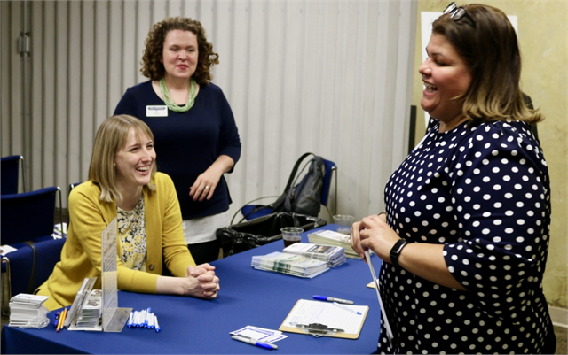 Tammy Rivera (right), Executive Director of the Southside Organizing Center, is welcomed to the session by Kristen Leffelman of the Wisconsin Historical Society (seated) and Anna Altschwarger of the Society's historic site Old World Wisconsin.