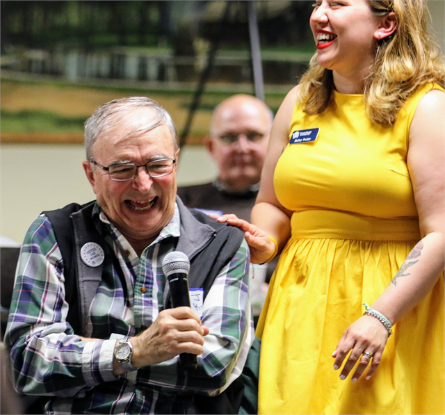"Jim Kraft laughs after being surprised with the microphone by Halley Pucker of the Wisconsin Historical Society during the ""Share Your Voice"" new museum listening session in Wausau."