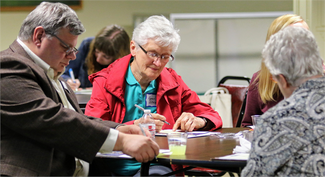 "(From left) Keene Winters, Agnes Gliniecki and Laurel Hoffman write suggestions about what makes the Wausau area special during the Wisconsin Historical Society's ""Share Your Voice"" new museum listening session June 10, 2019 in Wausau."