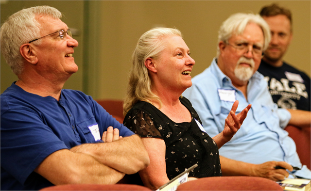 "Margaret Berres (center) smiles as she talks about fish fries, as Tom Ludka (left) and George Wagner look on during the Wisconsin Historical Society's ""Share Your Voice"" new museum listening session June 27, 2019 in St. Francis."