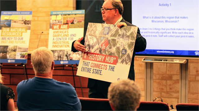 "Wisconsin Historical Society Director Christian Øverland shows guests where the new Wisconsin history museum will be located on the Capital Square in Madison during the ""Share Your Voice"" listening session June 27, 2019 in St. Francis."