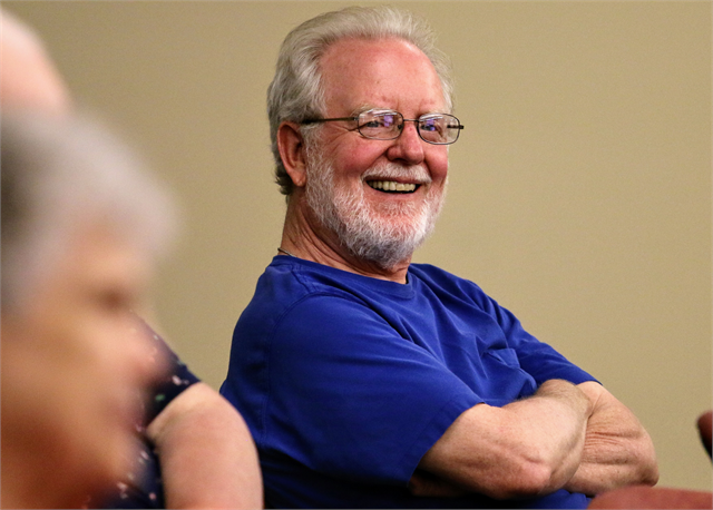 "Bill Drefahl laughs after suggesting ""beer"" would be an important topic to be addressed in a new state history museum during the Wisconsin Historical Society's ""Share Your Voice"" listening session in St. Francis."