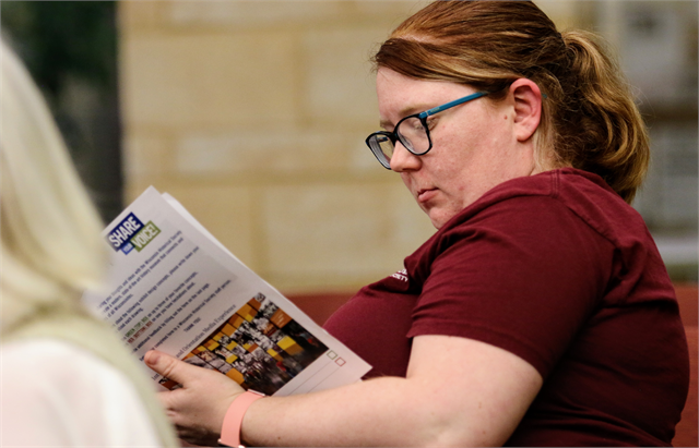 "St. Francis Historical Society board member Stephanie Maxwell reviews informational materials about the Wisconsin Historical Society's new state history museum project during the ""Share Your Voice"" listening session June 27, 2019 in St. Francis."