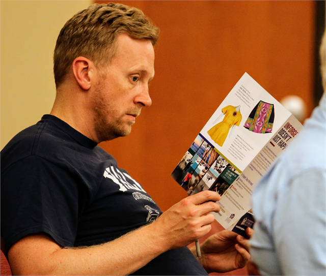 "Dan Berg reviews informational materials about the Wisconsin Historical Society's new state history museum project during the ""Share Your Voice"" listening session June 27, 2019 at the St. Francis Civic Center."