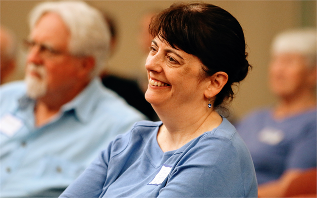 "Jane Taugher enjoys a laugh during a discussion at the Wisconsin Historical Society's ""Share Your Voice"" new museum listening session June 27, 2019 in St. Francis."