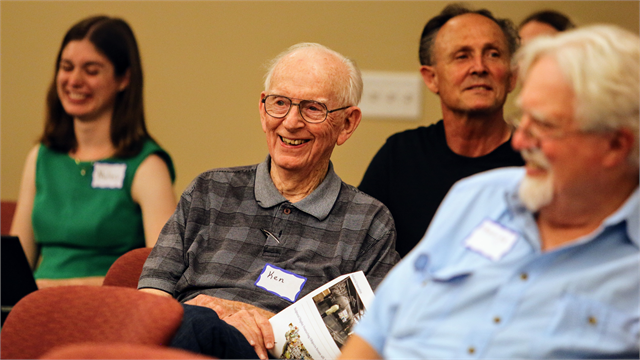 "Ken Germanson (center) and other guests laugh at a funny comment during the Wisconsin Historical Society's ""Share Your Voice"" new museum listening session June 27, 2019 in St. Francis."