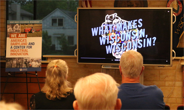 "Guests watch a film about the new Wisconsin history museum's main storytelling theme — ""What Makes Wisconsin, Wisconsin?"" — during the Wisconsin Historical Society's ""Share Your Voice"" listening session June 27, 2019 at the St. Francis Civic Center."