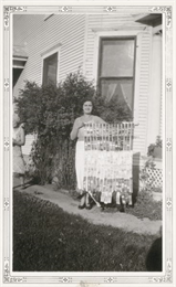 Elda Strahm holding array of ribbons from various fairs