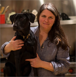 Photograph of author Mary Dougherty seated with a dog