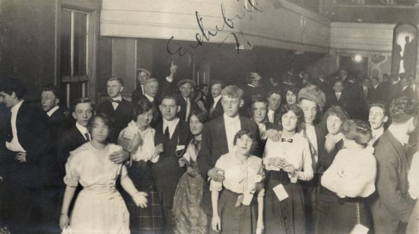 A group of people, including minors, in a saloon dance hall at 2 am in Milwaukee. The dance hall, Vizey's Hall, was on 8th Street and Walnut.
