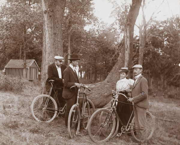 Bicyclists Standing Near a Tree, WHI 68012.