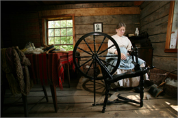 A woman spins some yarn.