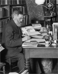 Rasmus Anderson seated in his study and taking notes from a book.