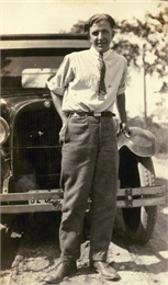 "Portrait of Angus ""Mac"" McVicar, age 20, in front of the new family car."