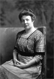 Studio portrait of Meta Berger seated.