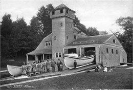 Exterior of boat house with crew.