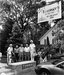 Five people are posing outside Timmer's Restaurant before going in for a fish-fry dinner.