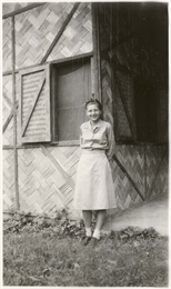 Signe Skott Cooper standing outside building.