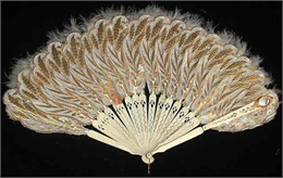 Decorative hand-held fan with ivory feathers.