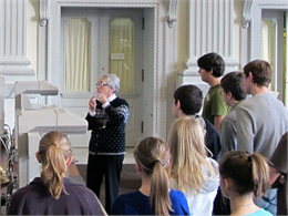 A librarian giving a tour to a group of researchers.