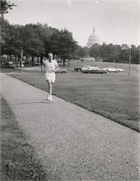Proxmire jogging in a park near the U.S. Captiol.