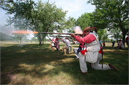 Riflemen fire at the enemy during the annual War of 1812 in Wisconsin event at Villa Louis.
