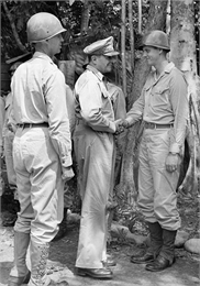 General Douglas MacArthur greets a soldier during a tour on Goodenough Island, in the Solomon Sea, New Guinea (present day Papua New Guinea).