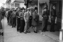 Members of the United Automobile Workers union, Local 75, line up outside the local's headquarters to vote on delegates to the union's convention.