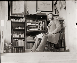 Self-portrait of Dr. Edward A. Bass sitting in his Pratt house office.