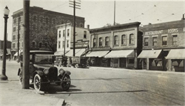 Left to right are the Cardinal Hotel, 416-18 East Wilson Street; Lake City House, 502 East Wilson Street; Louis Russos candy store, 504 East Wilson Street; Herman Klueter grocery & real estate, (continued on image record)