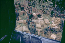 Dropping supplies at a South Vietnamese army outpost. Photographer Dickey Chapelle of Milwaukee was on board the helicopter as the drop was taking place.