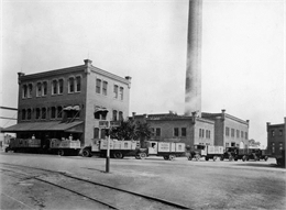 Horlick's Malted Milk Corporation depot with receiving trucks.