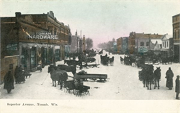 View of Superior Avenue, with the Tomah Hardware store in the left foreground.