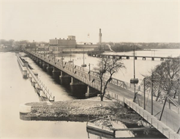 View of the bridge over the Fox river, and the Nicolet Paper Company in the distance.