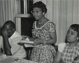 A woman speaking at a Civil Rights workshop.