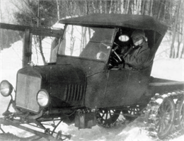 "Dr. Kate Pelham Newcomb driving her ""snow machine,"" a kind of vehicle for wading through snow."