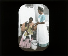 A nurse with a young girl and mother.