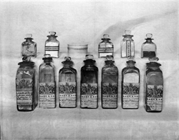 Display of 18th and 19th century English medicine bottles.