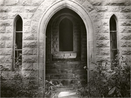 An exterior view of the rear doorway to the Banjamin Walker Castle, 1862-1893 in the 900 block of East Gorham Street.