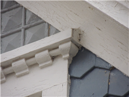 Image of a drip cap with a steep angle installed over a window.