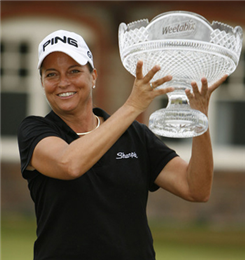 Sherri Steinhauer holds the Weetabix trophy