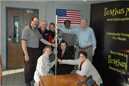 Wagner employees pose with a Festivus pole