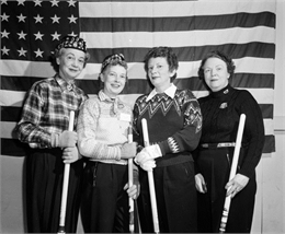 Group portrait of Madison Curling Club's Jamieson Rink at the United States Women's Curling Association bonspiel. Left to right: Madeline Hefty, Edith Resan, Elynore Wegner, Myrtle Jamieson.
