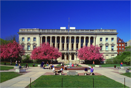 Front of the Wisconsin Historical Society HQ with blooming trees