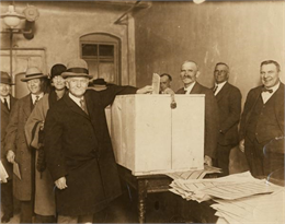 Senator Robert M. La Follette, Sr., a third-party presidential candidate, prepares to drop his ballot into the ballot box