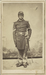 "Full-length portrait of Sargeant Major Meekins. Co. ""K"" 36th U.S. Colored Troops."