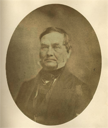 Quarter-length oval portrait of Henry L. Baird.