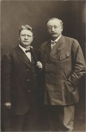 Three-quarter length formal studio portrait of Victor Berger and Emil Seidel.
