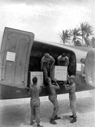 Soldiers loading crates of blood at Falalop Island.